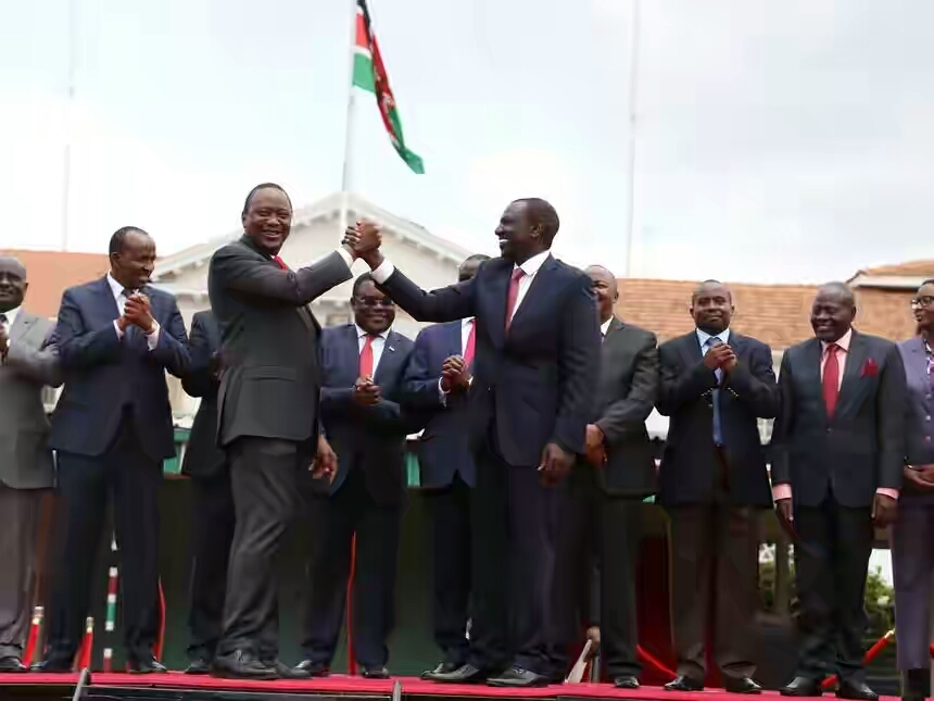 president_uhuru_kenyatta_and_his_deputy_william_ruto_with_a_section_of_political_parties_leaders_and_officials_at_state_house_after_they_announced_the_official_merger_of_a_section_political_parties