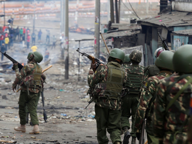 Anti-riot policemen arrive to disperse protesters in Mathare, in Nairobi