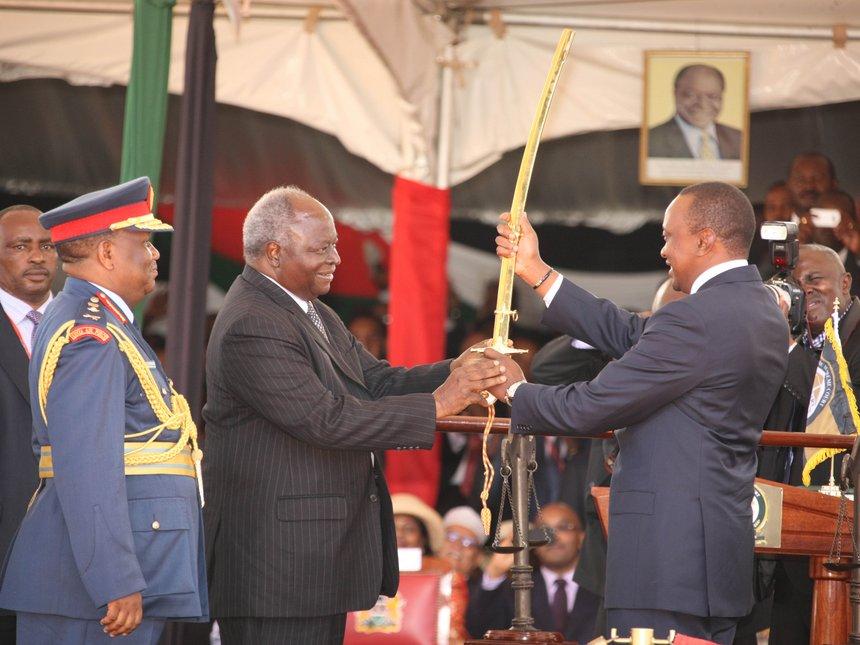 kibaki_hands_over_to_uhuru_kenyatta_during_the_state_installation_on_april_9_2013_0