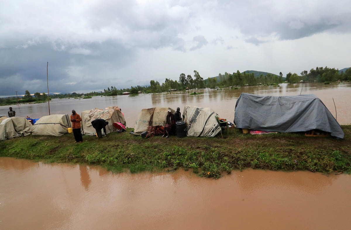 Residents set up makeshift shelter on a raised ground after they evacuated from their homes after River Nzoia burst its banks and due to the backflow from Lake Victoria